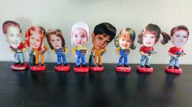 When I moved to Florida, my family gave me bobbleheads of themselves. They are Pep Boys bobbleheads with their faces shaved off and baby pictures of my family velcroed on. Last year, they gave me three more bobbleheads (sans faces) and was instructed to make ones for myself, Matt and my niece, Charlie.