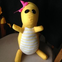 When a friend or family member has a baby, I make a stuffed animal for them. The idea is for them to take a picture of the baby and the stuffed animal each month to show how much the baby has grown. This is Lola — dino friend of my friend Kim's daughter Lianna.