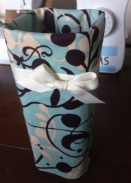 Using fabric remnants and a plastic container that one my Christmas gifts came in, I made a vase. I don't have flowers often, but I made it anyway.